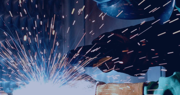 Person Welding a Metal Product